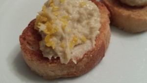 Toasted Baguette topped with Garlicky White Bean Dip and a sprinkling of Fresh Lemon Zest  (Photo Credit: Adroit Ideals)