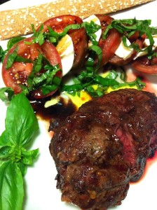 Tomato Mozzarella Basil Salad with Balsamic Vinegar Syrup and Olive Oil accompanies a Grilled Filet Mignon (Photo Credit: Adroit Ideals)