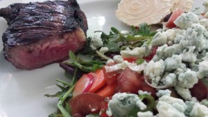 Grilled Strip Steak served with a Hearty Vegetable Salad dressed with Roasted Walnut Oil Dressing and a handful of Bleu Cheese Crumbles (Photo Credit: Adroit Ideals)
