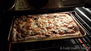 Tasty Pizza made with my Easy Pizza Crust and Roasted Tomato Sauce (Photo Credit: Adroit Ideals)