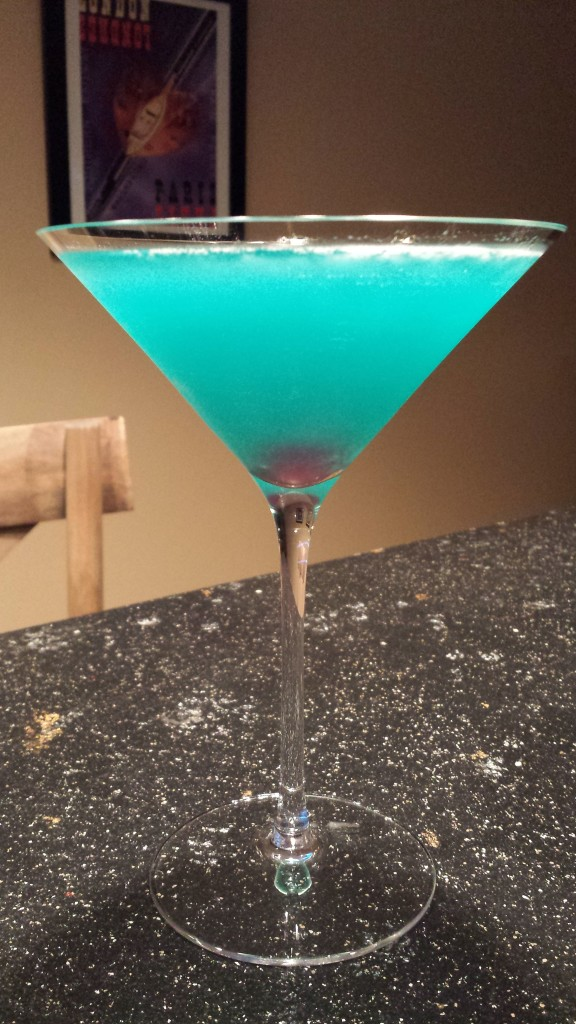The Blue Hawaiian Cocktail is a lovely shade of azure and hides a hot pink cherry at the bottom! (Photo Credit: Adroit Ideals)