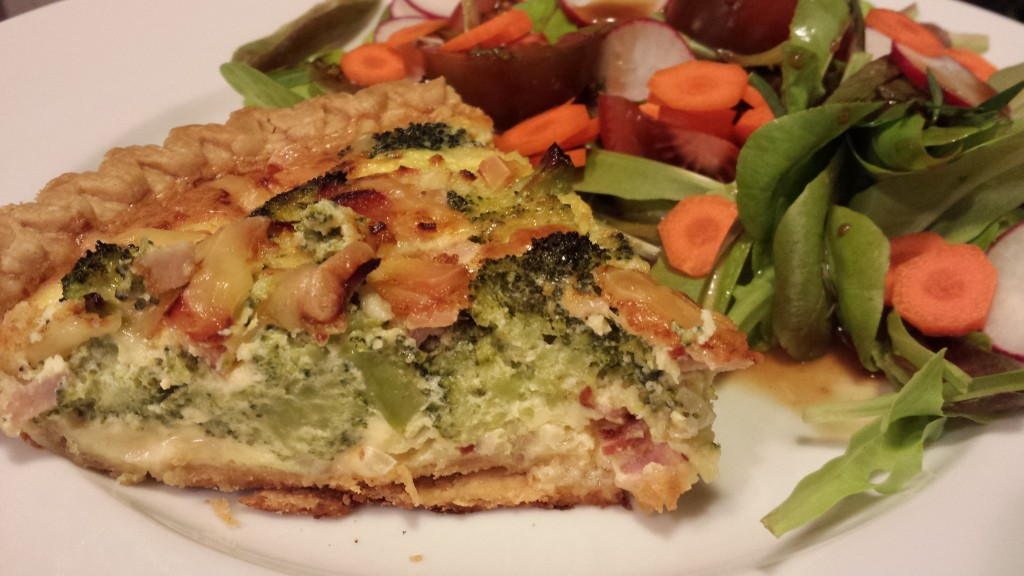 A slice of Broccoli, Ham, and Smoked Gouda Quiche along with a Garden Salad  (Photo Credit: Adroit Ideals)