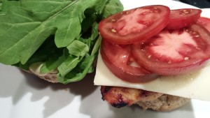 Add the Tomato Slices and Arugula to the Sandwich (Photo Credit: Adroit Ideals)