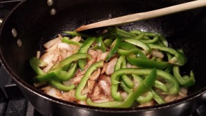 Add the green bell pepper slices (Photo Credit: Adroit Ideals)