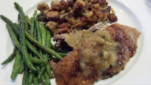 Roasted whole duck with a Granny Smith apple and local apple cider pan sauce. Sage apricot pecan cornbread dressing. Sauteed garlicky haricots verts. (Photo Credit: Adroit Ideals)