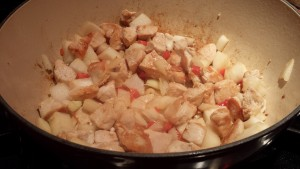Add the diced onion and red bell pepper to the chicken mixture (Photo Credit: Adroit Ideals)