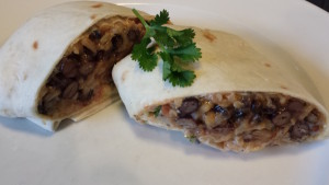 Black Bean Brown Rice Burrito with Cheeses, Homemade Salsa, Chipotle Cream Dressing, and Cilantro (Photo Credit: Adroit Ideals)