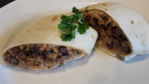 Sliced Black Bean Brown Rice Burrito ready to eat (Photo Credit: Adroit Ideals)