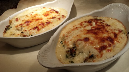 Baked manicotti, tops browned, and hot from the oven (Photo Credit: Adroit Ideals)