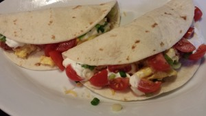 Breakfast Tacos: Flour Tortillas stuffed with Spicy Chorizo, Scrambled Eggs, Green Chile, Shredded Cheeses, Cherry Tomatoes, Sour Cream, Scallions (Photo Credit: Adroit Ideals)