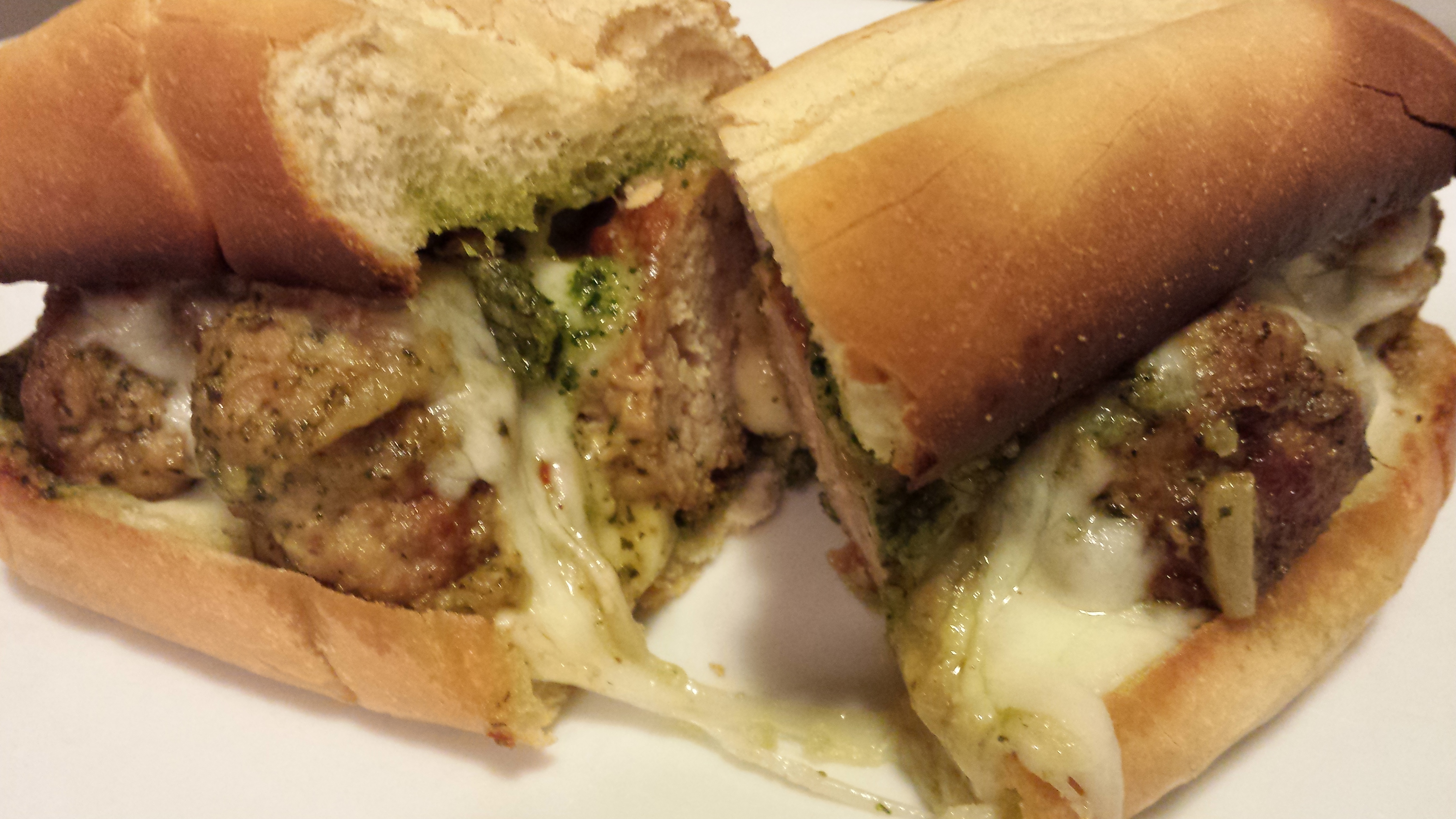 Cheesy Pesto Turkey Meatball Sandwich (Photo Credit: Adroit Ideals)