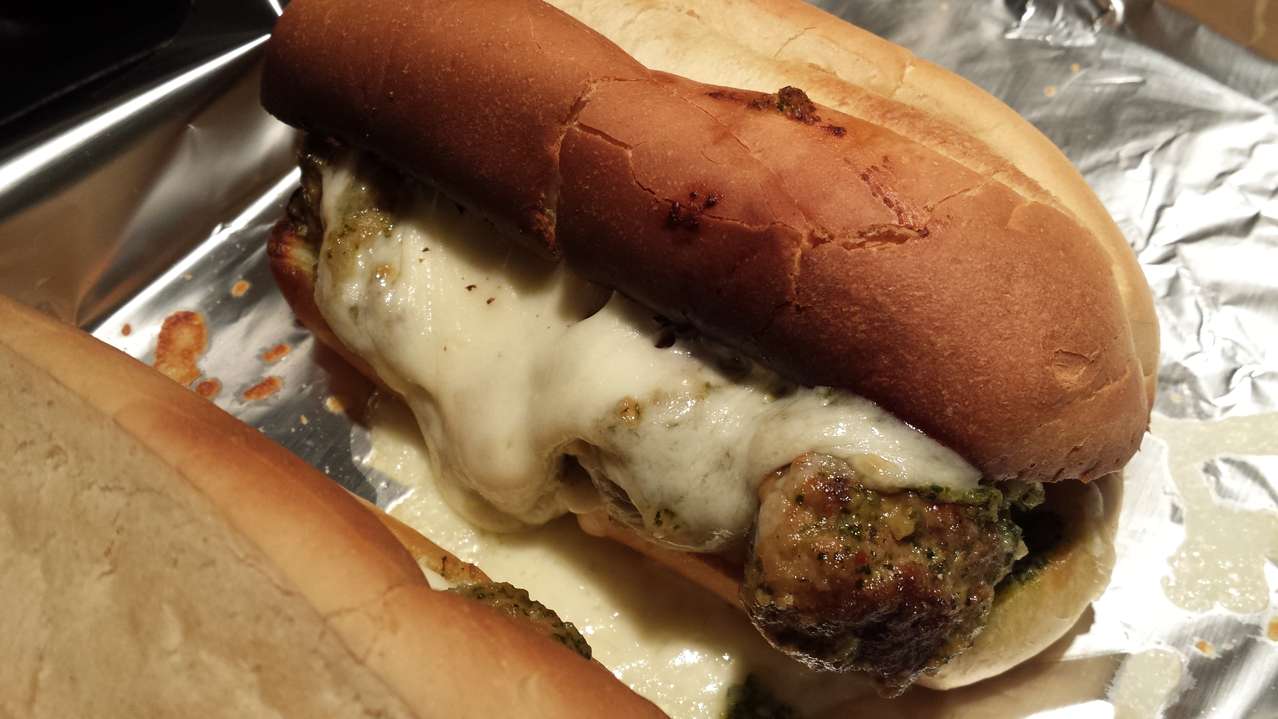 Fresh from the oven and ready to eat: Pesto Turkey Meatball Sandwich (Photo Credit: Adroit Ideals)