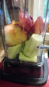Add the fruit and cucumber to the blender (Photo Credit: Adroit Ideals)