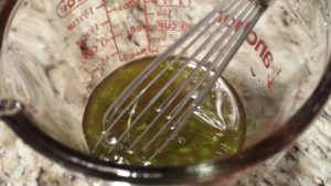 Whisk together the ingredients for the dressing  (Photo Credit: Adroit Ideals)