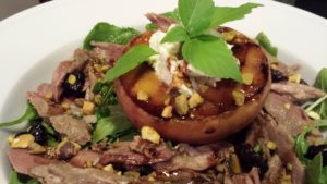 Chilled Grilled Peach tops a Smoked Duck Salad  (Photo Credit: Adroit Ideals)