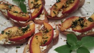 Peach Pistachio Ricotta Toasts make a great appetizer (Photo Credit: Adroit Ideals)
