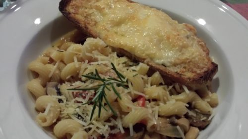 Cheesy Garlic Rosemary Toast served with pasta (Photo Credit: Adroit Ideals)