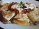 Melty Four Cheese and Black Refried Bean Quesadilla topped with Pico de Gallo and Chipotle Cream Dressing