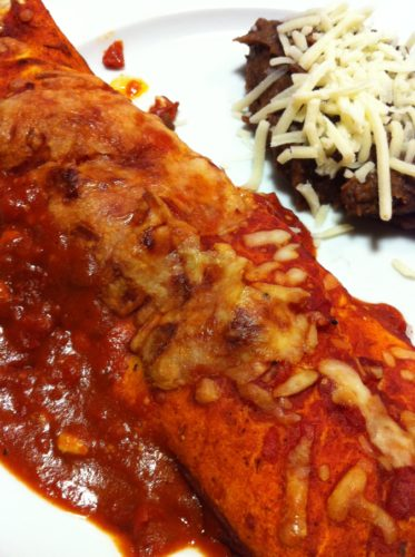 Cheese enchiladas with refried black beans