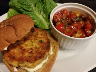 Salmon patty sandwich with insalata caprese