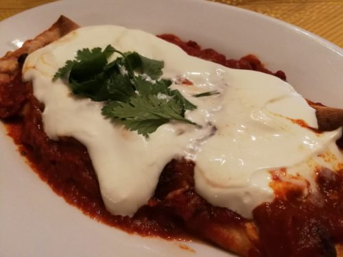 Sour cream tops enchilada