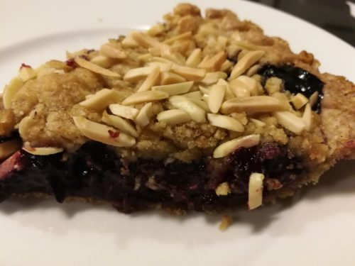 slice of blueberry crumble pie
