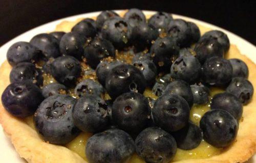 fresh blueberries on top of lemon curd filling