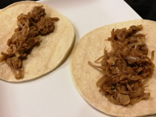 Put jackfruit carnitas on corn tortillas