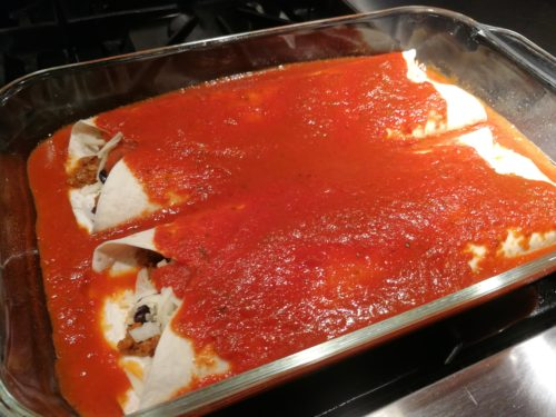 cover enchiladas with sauce