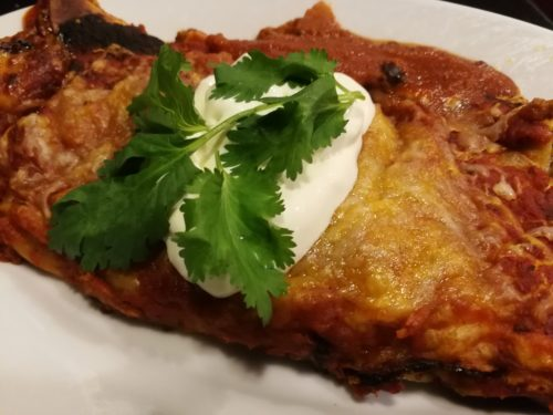 sour cream cilantro on enchilada