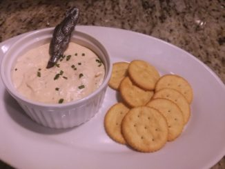 spread rich smoked salmon dip on crackers