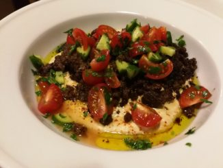 Hummus topped with spicy ground beef, tomato, cucumber, parsley, olive oil