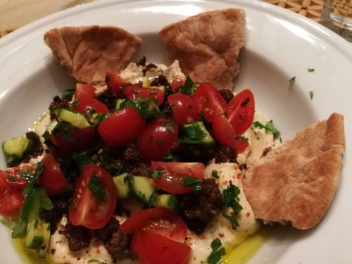 spicy beef cherry tomato hummus bowl with pita