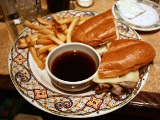 French dip sandwich with au jus sauce for dipping