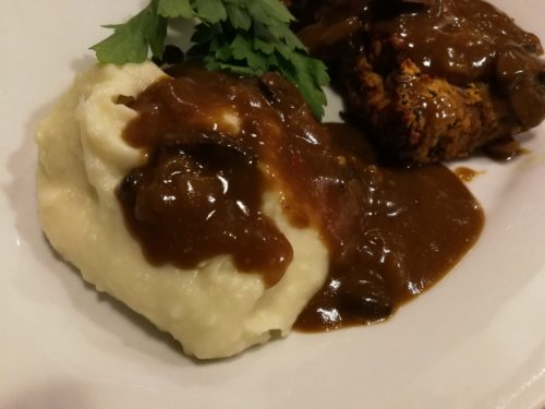 Lentil loaf with mashed potatoes and mushroom gravy