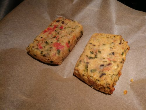 Two slices of thawed lentil loaf ready to broil
