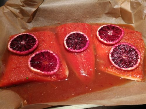 Pour marinade over salmon in baking pan