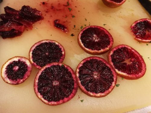 Slice and section the blood oranges
