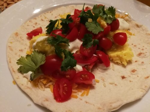 Add tomatoes, cilantro, sour cream, cheese to Just Egg