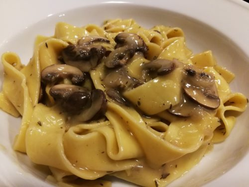 Plate the mushroom pappardelle pasta