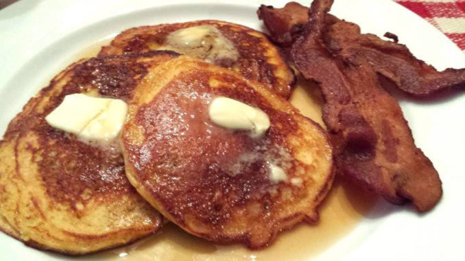 Fluffy buttermilk pancakes with a side of bacon