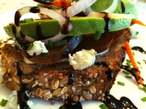 Detailed closeup of Avocado Veggie Bleu Toast