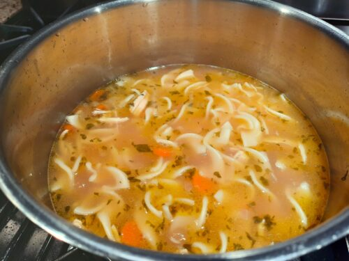 Hearty Chicken Noodle Soup Simmers in a Pot