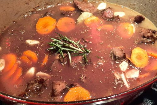 Add chicken stock, wine, herbs to pot