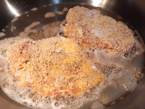 Add the second schnitzel to the skillet